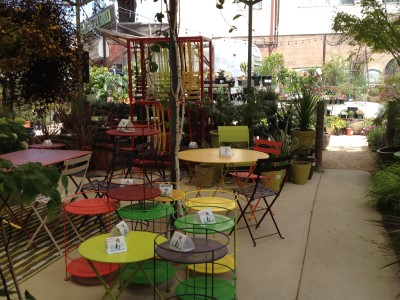 Colorful bistro tables and chairs welcome you to Flowerland.