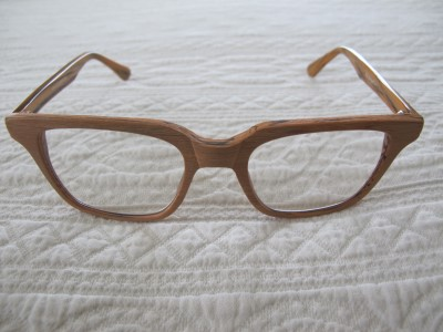 Reading glasses of faux wood.
