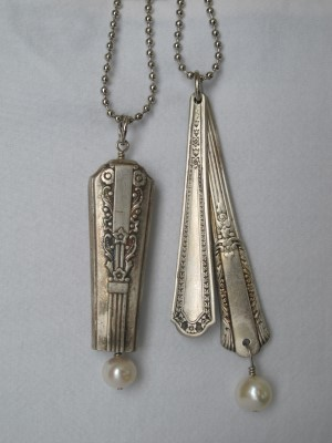 My treasures - vintage silverware with intricate scrollwork and drop pearls.