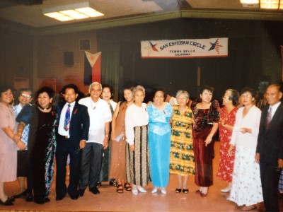 The dance in 1997. My mom is sixth, from the right. I'm next to her, and Janet's mom, Auntie Virgie, is on the other side of me.