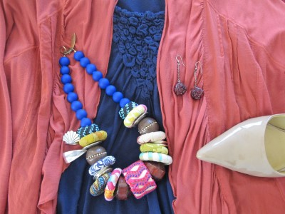 "A colorful bold ""tribal"" necklace serves as the centerpiece to pull the rest of the outfit together."