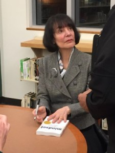 Carol Dweck listens raptly to a parent's request for advice.