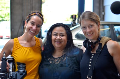 Emily Fraser, Mae De La Calzada of Lady Parts Automotive, and Katherine Gorringe, taking a break from filming.