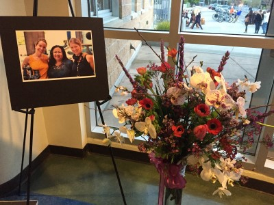 A tribute to Mae De La Calzada, owner of Lady Parts Automotive - a beautiful bouquet and photo of Emily and Katharine and Mae De La Calzada.