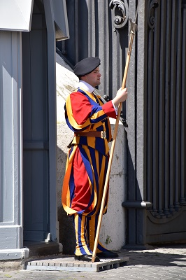 A colorful Swiss guard keeping watch over the Vatican.