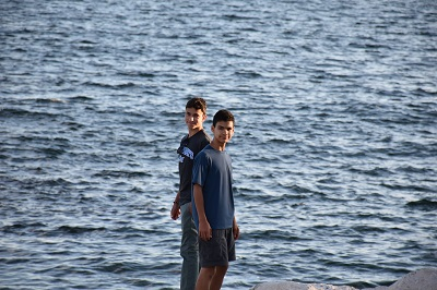 Two young men by the seashore.