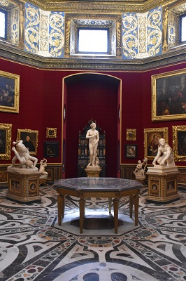 A beautiful room with sculptures.