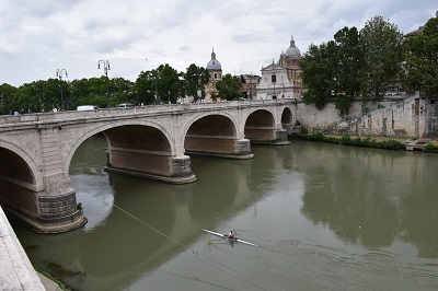 Lone rower on the Tiber River. On our way to Trevi Fountain.