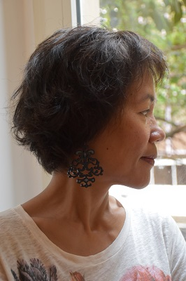 Wearing my Disegno earrings while looking out of our Roma apartment living room window.