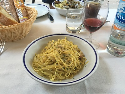 Tortellini with claim sauce.