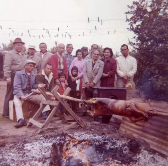 One of Annie's photos from the 1960s: roasting a pig in her family's backyard. I recognize many of my relatives here and recognize my dad's red sweater. He's holding onto me. I'm guessing the terror on my sister Joyce's and my face is from watching a pig being roasted. Vegetarian friends, look away!