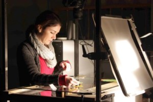 "Sarah at work on ""A Foreign Genie,"" a one-minute, stop-motion, cut-out film she made while studying in La Poudrière in 2011."