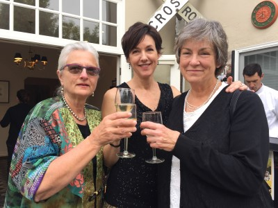 Chair Joann Steck-Bayat, Peggy Murphy, and Laurie Schumacher, whose daughter is one of the filmmakers this year, share a toast before the VIP guests arrive.