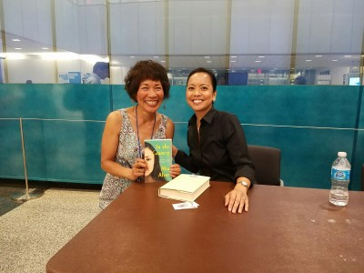 Mia Alvar, me, and a signed copy of her book.