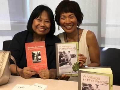 Vickie Santos and me at the FANHS Bay Area Consortium chapter table with our books.