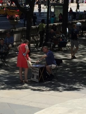 An enterprising writer sets up shop in front of the NYPL. What a great idea!