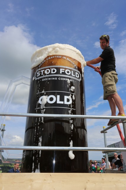 Angus Wood, co-founder of Stod Fold Brewing Company, fills the glass with Stod Fold's GOLD ale.