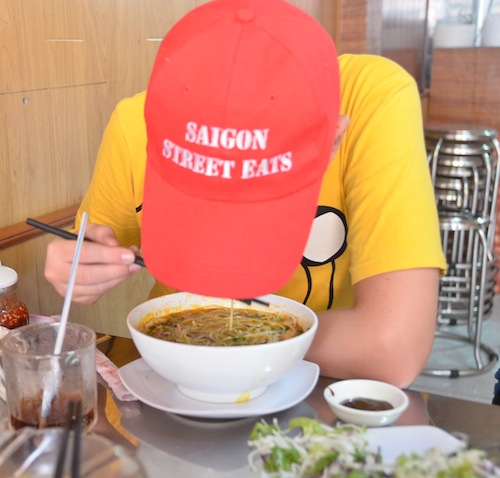 Tracey's son Jono modeling one of our tour hats. And eating.