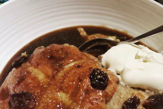 Hot cross bun and butter pudding with rum raisins