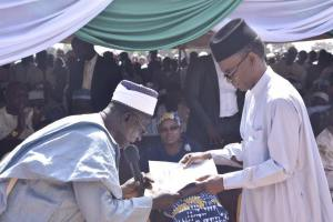 "Gov. Rufai Presenting a copy of ""The Kafanchan Peace Declaration"" at the Installation of the new Agwatyap"
