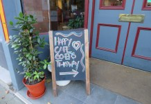 A board outside The Happy Cafe