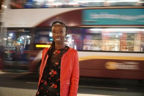 Headshot of Eunice Olumide with Lothian Bus behind