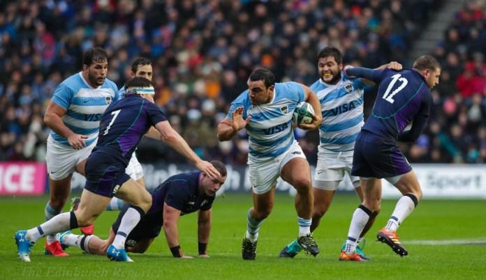 Augustin Creevy batters his way through the Scots' line
