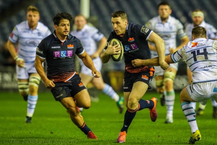 Edinburgh player avoiding a tackle