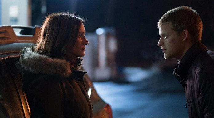 Actors Julia Roberts and Lucas Hedges in character in the film