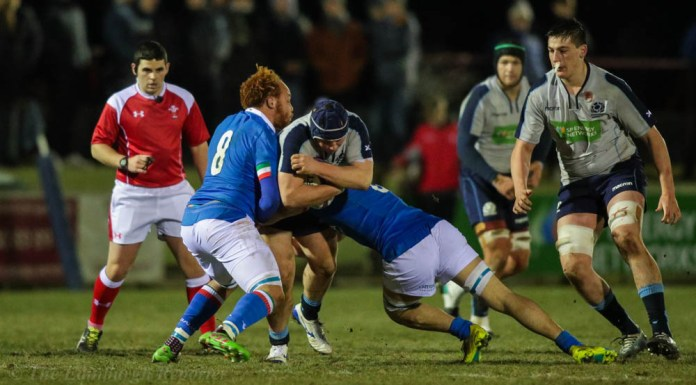 Scotland player being tackled