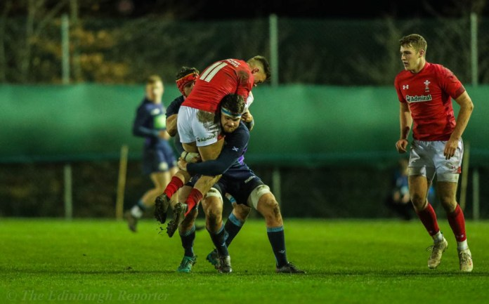 Two Scottish players tackle Welsh player