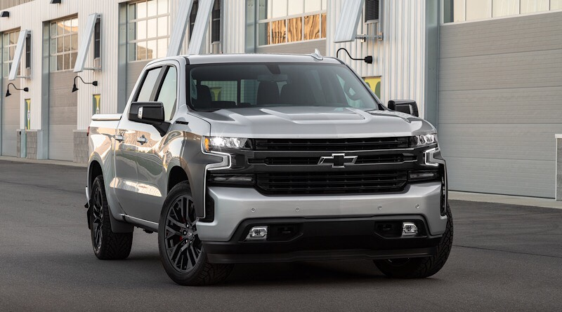 """The concept truck sports a lowered suspension and custom black body-side graphics, as well as 22"""" black wheels and carbon-fiber lookalike accents both inside and out."""