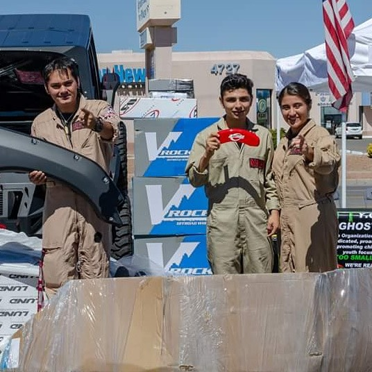 YOUNG Ghostbusters presented with donated product for their truck.