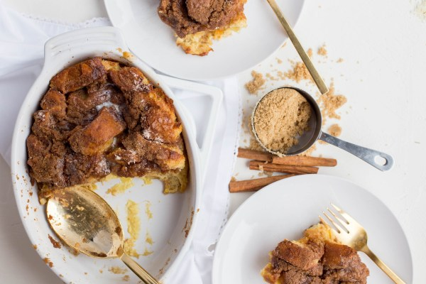 Baked French Toast Casserole served out to guests beside a mess of cinnamon and brown sugar