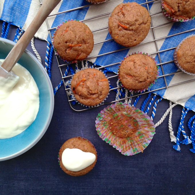 Carrot Muffins with Pineapple Cream Cheese Glaze - healthy enough for breakfast, sweet enough for that afternoon treat! At www.mybottomlessboyfriend.com