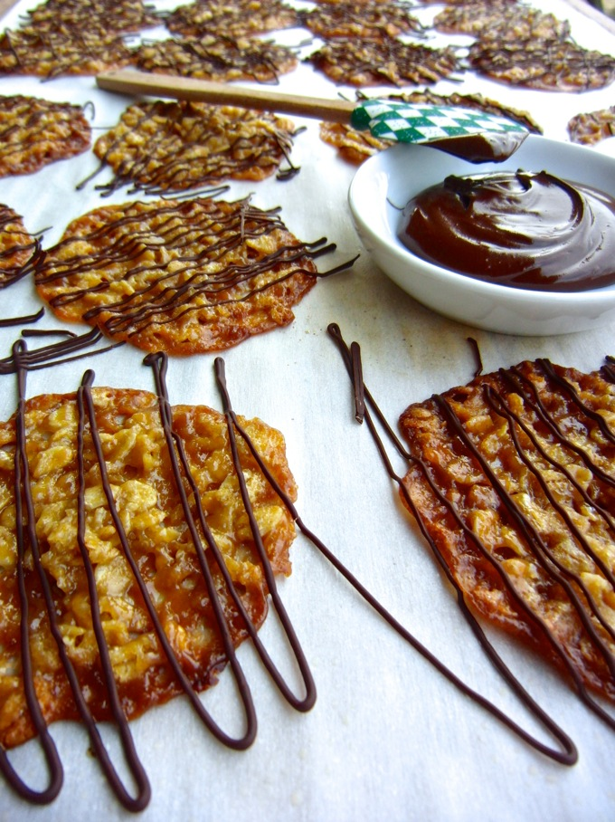 Oatmeal Lace Cookies drizzled with chocolate. Get the recipe at www.mybottomlessboyfriend.com