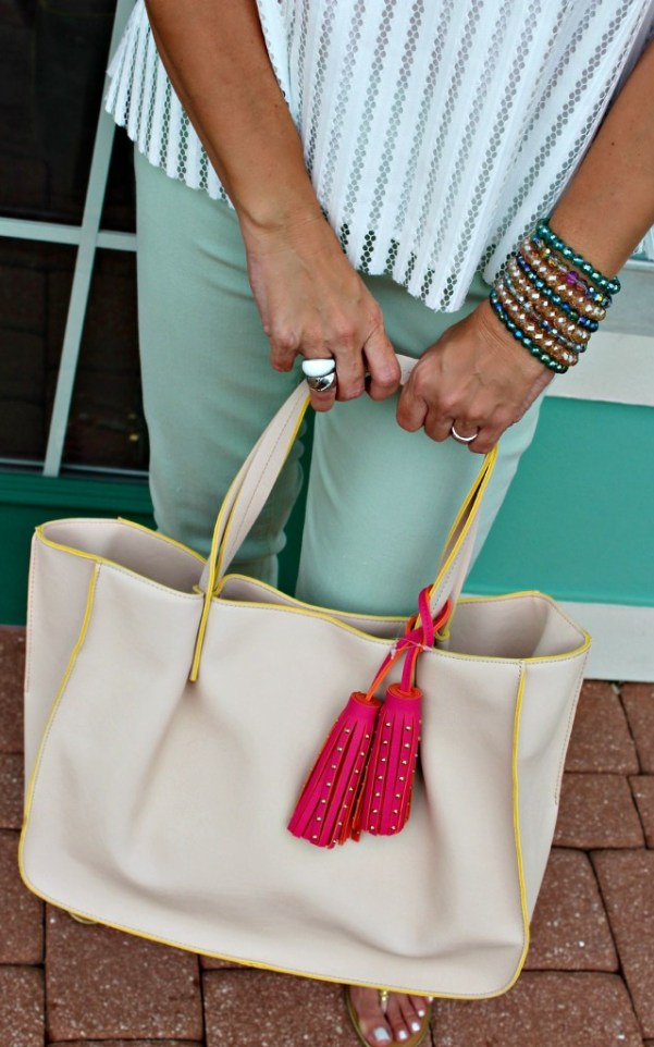 Minty Cool Jeans and a Breezy Top, paired with a pink tasseled purse