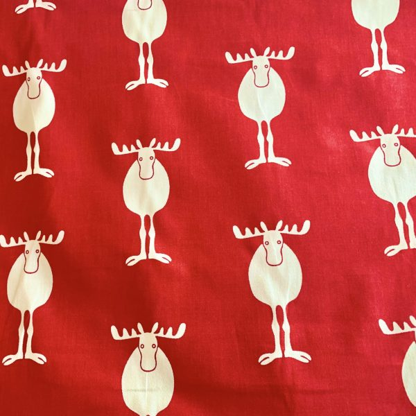 reindeer print on red fabric