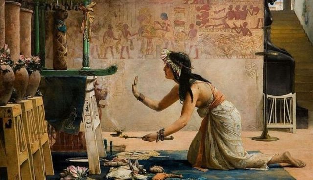 Ancient Egyptian woman worshipping cats.
