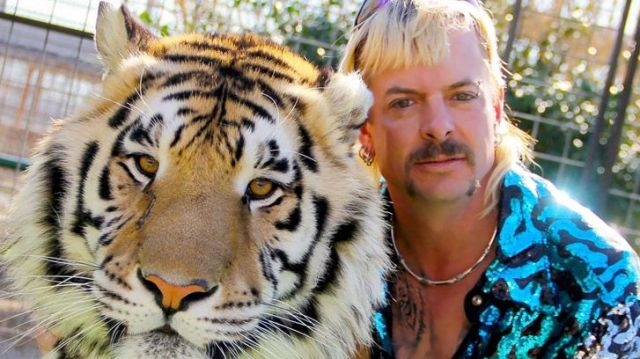 Joe Exotic and one of his tigers