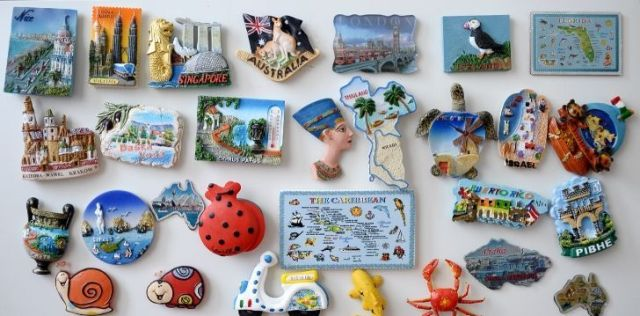 A large collection of fridge magnets collected on vacations