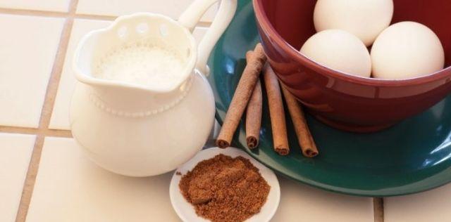 Eggnog ingredients egg, milk, and cinnamon