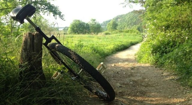 A unicycle on a countryside trail