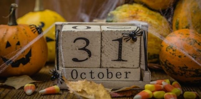 A picture of date blocks for 31 October covered in webs