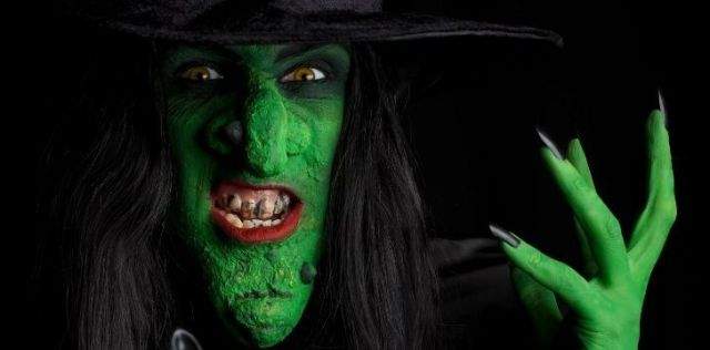 A scary witch with green skin