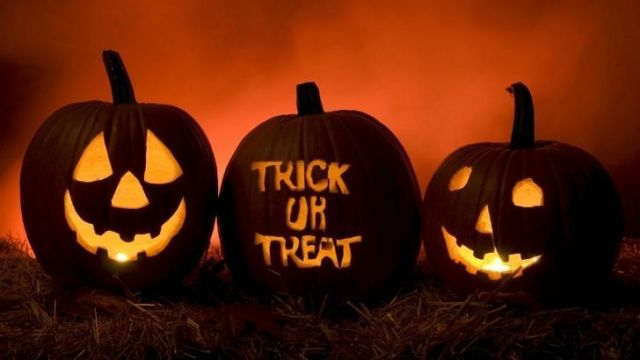 """Three pumpkins, two with faces and one reading """"Trick or Treat"""""""