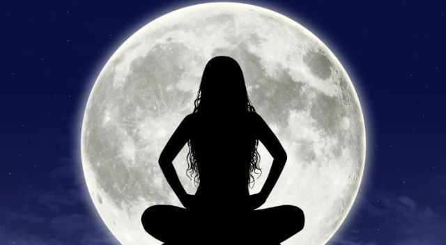 Silhouette of a woman infant of a big full moon