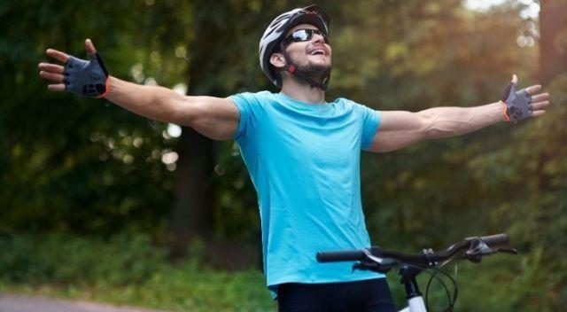 A man enjoying his bicycle ride