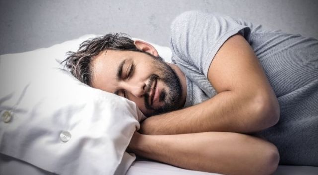 a man sleeping with a smile on his face