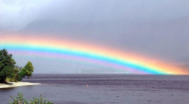 A rainbow over a lake
